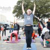 Yogis Unite for Holiday Yoga Flash Mob!
