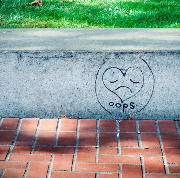 sorry apology oops sidewalk outside graffiti heart