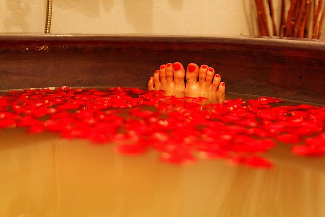 bath tub feet red toes