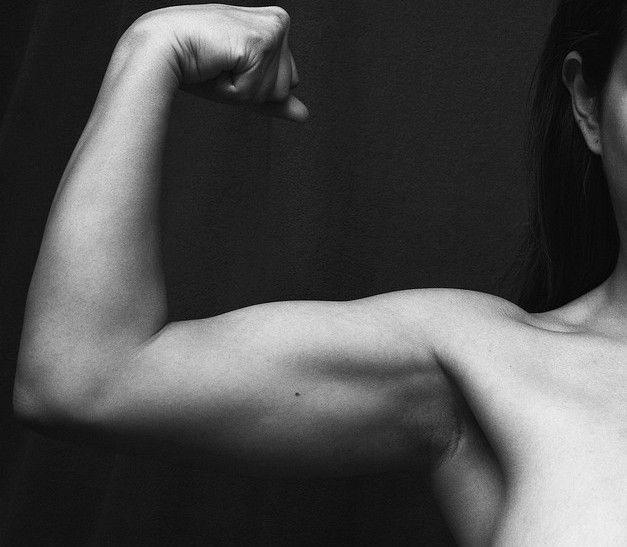 woman strong arm bicep