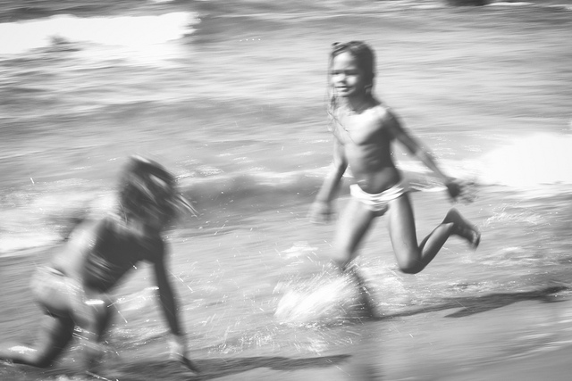 joy kids playing ocean