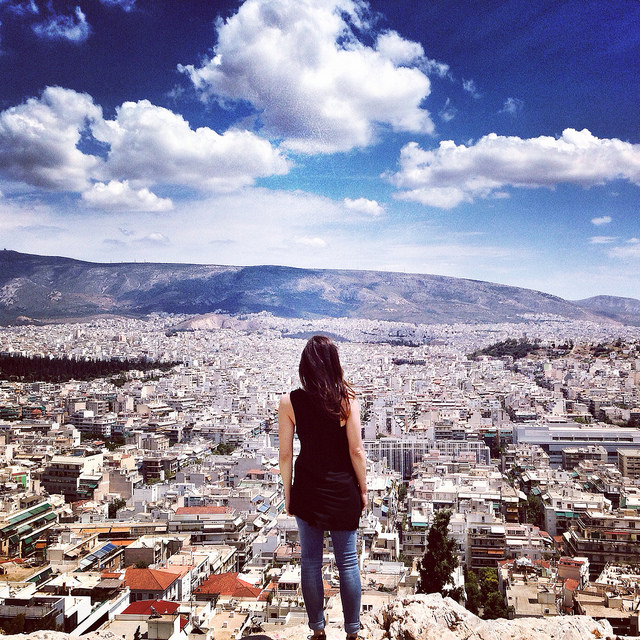girl woman city athens blue sky clouds alone
