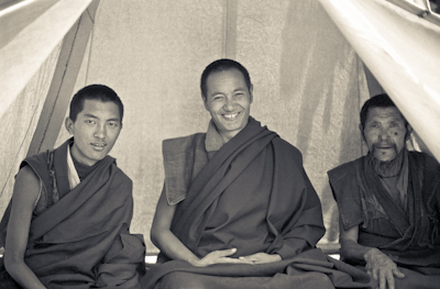 Lama Zopa Rinpoche and Lama Yeshe with an unidentified monk in a tent at the Lawudo Retreat Centre, 1972