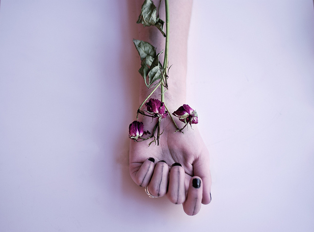 flower wrist hand giving