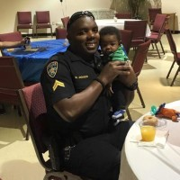 """This is officer Montrell Jackson & his baby boy. Officer Jackson was one of the officers killed today in Baton Rouge in the line of service."""