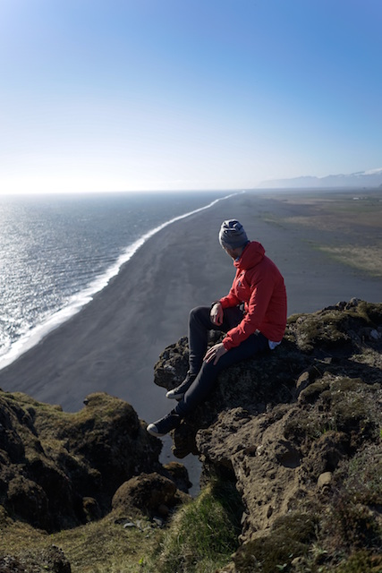 man sit beach climb nature view search look