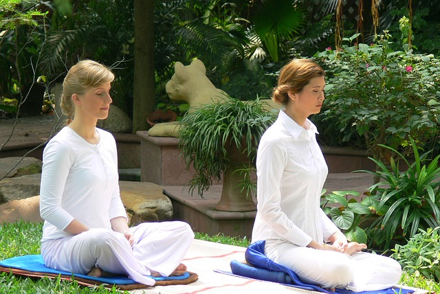 Two women Buddhist spa temple meditation