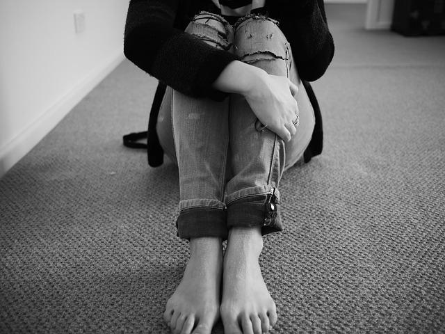 woman jeans sad alone