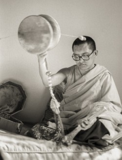 (25288_ng.TIF) Lama Zopa Rinpoche at Manjushri London (currently Jamyang Buddhist Centre), 1983. In this series he is playing the Chod damaru (drum). Photos by Robin Bath.