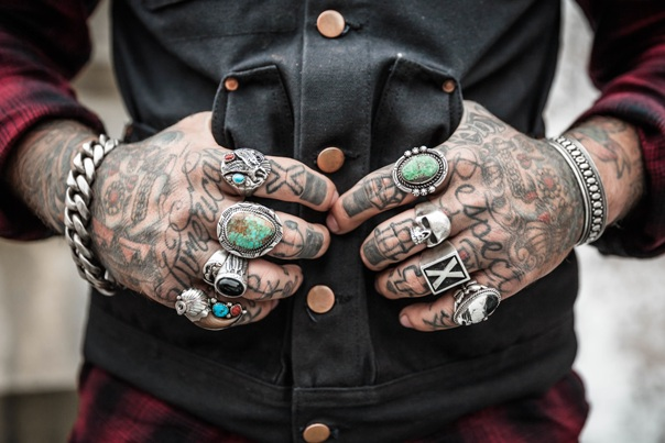 tattoos hands vest man