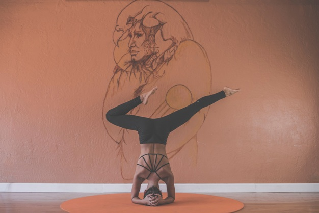 yoga pose head hand stand