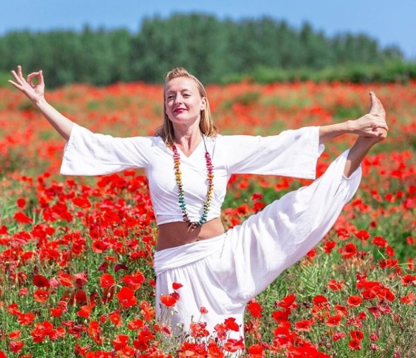 woman in field of poppies