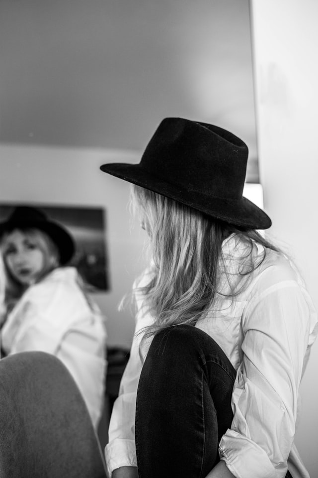 women looking in mirror, choice