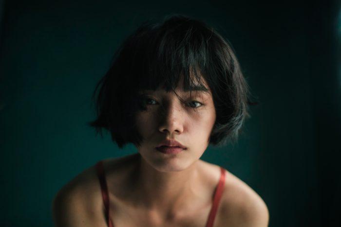 Ike Louie Natividad/Pexels https://www.pexels.com/photo/tender-ethnic-lady-in-room-with-green-wall-6279440/